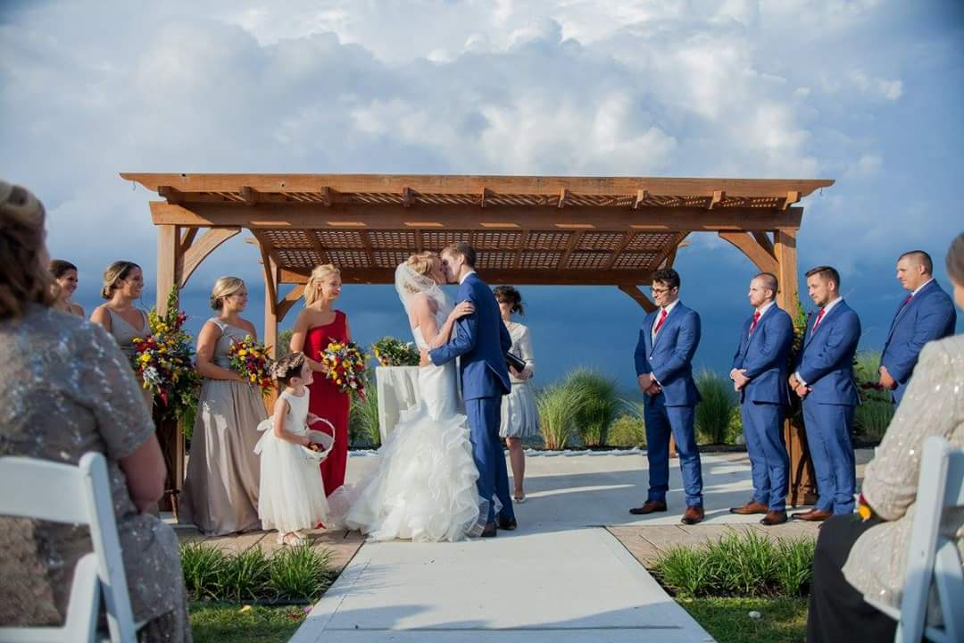 Photo of a wedding with clouds in the background